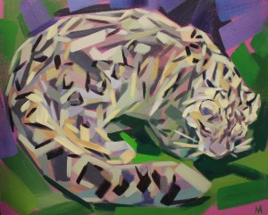 Snow Leopard lieing down in the bush